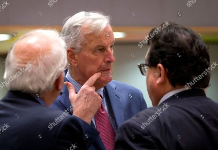 EU chief Brexit negotiator Michel Barnier, center, speaks with Spain's Minister of Foreign Affairs Josep Borrell, left, and Spanish Secretary of State Luis Marco Aguiriano Nalda, left, during a meeting of EU General Affairs ministers, Article 50, at the Europa building in Brussels on