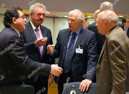 Spain's Minister of Foreign Affairs Josep Borrell, center right, and Spanish Secretary of State Luis Marco Aguiriano Nalda, left, speak with Luxembourg's Foreign Minister Jean Asselborn, second left, and Portuguese Foreign Minister Augusto Santos Silva, right, during a meeting of EU General Affairs ministers, Article 50, at the Europa building in Brussels on