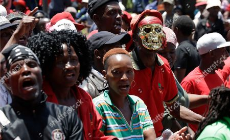 Members of the Economic Freedom Fighters (EFF) protest outside the venue where Public Enterprises Minister Pravin Gordhan appears at the judicial commission of inquiry into state capture in Johannesburg, South Africa. . Gordhan is expected to reveal details surrounding former president Jacob Zuma's trillion-rand nuclear procurement campaign as well as other corruption practices