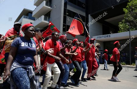 Stock Image of Members of the Economic Freedom Fighters (EFF) protest outside the venue where Public Enterprises Minister Pravin Gordhan appears at the judicial commission of inquiry into state capture in Johannesburg, South Africa. . Gordhan is expected to reveal details surrounding former president Jacob Zuma's trillion-rand nuclear procurement campaign as well as other corruption practices