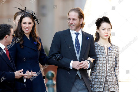Andrea Casiraghi, center, his wife Tatiana Casiraghi, left, and niece of Prince Albert II of Monaco, Camille Gottlieb, right, arrive at the Monaco cathedral before ceremonies marking the National Day in Monaco, Monday, Nov.19, 2018