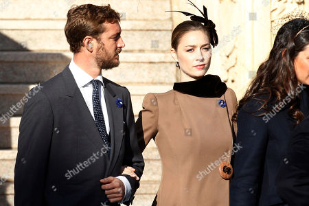 Princess Caroline of Hanover' son Pierre Casiraghi, left, and his wife Beatrice Borromeo arrive at the Monaco cathedral before ceremonies marking the National Day in Monaco, Monday, Nov.19, 2018