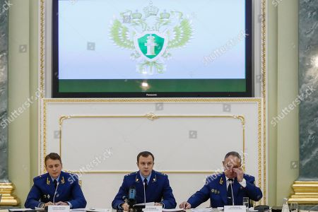 """Nikolai Atmoniev, Alexander Kurennoi, Mikhail Alexandrov. From left, an aide to the Russian Prosecutor General Mikhail Alexandrov, Russian Prosecutor General spokesman Alexander Kurennoi, and an aide to the Russian Prosecutor General Nikolai Atmoniev attend a news conference in Moscow, Russia, . Russian prosecutors on Monday announced new charges against Bill Browder, accusing him of forming a criminal group to embezzle funds in Russia. They also said they suspect Magnitsky's death in prison was a poisoning and said they have a """"theory"""" Browder is behind the poisoning"""
