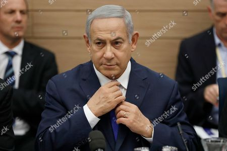Israeli Prime Minister Benjamin Netanyahu as he listens to the Foreign Affairs and Defense Committee for the first time as Minister of Defense of Israel in the Israeli Knesset, (Israeli Parliament), in Jerusalem, 19 November 2018. Media reports state that the Netanyahu government will not go to early elections after Naftali Bennett and Ayelet Shaked of the Jewish Home Party decided not to resign from the coalition. The elections are scheduled to take place in November 2019