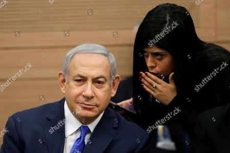 Israeli Prime Minister Benjamin Netanyahu (L) is spoken to as he listens to the Foreign Affairs and Defense Committee for the first time as Minister of Defense of Israel in the Israeli Knesset, (Israeli Parliament), in Jerusalem, 19 November 2018. Media reports state that the Netanyahu government will not go to early elections after Naftali Bennett and Ayelet Shaked of the Jewish Home Party decided not to resign from the coalition. The elections are scheduled to take place in November 2019