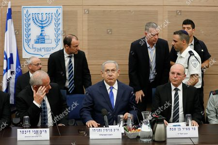 Israeli Prime Minister Benjamin Netanyahu (C) as he listens to the Foreign Affairs and Defense Committee for the first time as Minister of Defense of Israel in the Israeli Knesset, (Israeli Parliament), in Jerusalem, 19 November 2018. Media reports state that the Netanyahu government will not go to early elections after Naftali Bennett and Ayelet Shaked of the Jewish Home Party decided not to resign from the coalition. The elections are scheduled to take place in November 2019