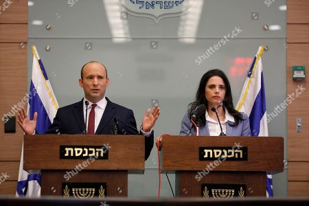 Israeli Minister of Education Naftali Bennett (L) and Justice Minister Ayelet Shaked speak during a press conference in the Israeli Knesset, (Israeli Parliament), in Jerusalem, 19 November 2018. Media reports state that the Netanyahu government will not go to early elections after Naftali Bennett and Ayelet Shaked of the Jewish Home Party decided not to resign from the coalition. The elections are scheduled to take place in November 2019