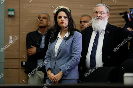 Israeli Minister of Justice Ayelet Shaked and Knesset member Eli Ben-Dahan (R) during a press conference in the Israeli Knesset, (Israeli Parliament), in Jerusalem, 19 November 2018. Media reports state that the Netanyahu government will not go to early elections after Naftali Bennett and Ayelet Shaked of the Jewish Home Party decided not to resign from the coalition. The elections are scheduled to take place in November 2019