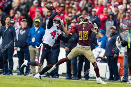 Houston Texans defensive back Shareece Wright (43) defends against a pass intended Washington Redskins wide receiver Josh Doctson (18) during the second half of the NFL game between the Houston Texans and the Washington Redskins at FedExField in Landover, Maryland