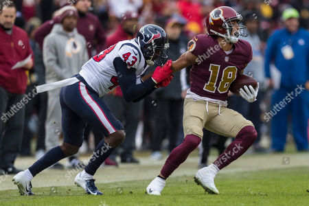 Houston Texans defensive back Shareece Wright (43) tackles Washington Redskins wide receiver Josh Doctson (18) during the second half of the NFL game between the Houston Texans and the Washington Redskins at FedExField in Landover, Maryland