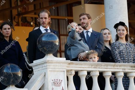 Andrea Casiraghi (2-L), his wife Tatiana, Pierre Casiraghi (3-R), and Princess Alexandra of Hanover attend the celebrations marking Monaco's National Day at the Monaco Palace in Monaco, 19 November 2018.