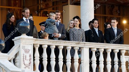 Andrea Casiraghi (2-L), his wife Tatiana, Pierre Casiraghi (C) and his wife Beatrice, Princess Alexandra of Hanover, Pauline Ducruet and Louis Ducruet attend the celebrations marking Monaco's National Day at the Monaco Palace in Monaco, 19 November 2018.