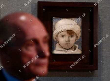 Bernard Ruiz-Picasso, grand-son of Pablo Picasso, speaks in front of Portrait of Paul Picasso as a Child (1923) by his grandfather  during opening ceremony of an exhibition titled 'Picasso and Khokhlova' dedicated the first wife of Pablo Picasso Russian ballet dancer Olga Khokhlova in the Pushkin State Museum of Fine Arts in Moscow, Russia, 19 November 2018. The new art project will be the first experience in collaboration of the Moscow museum and the La Caixa Foundation, Spain.