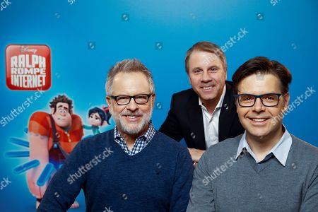 Rich Moore (L) and Phil Johnston (R) and producer Clark Spencer (C) pose for photographers during the presentation of their animation movie 'Ralph Breaks the Internet' in Madrid, Spain, 19 November 2018.