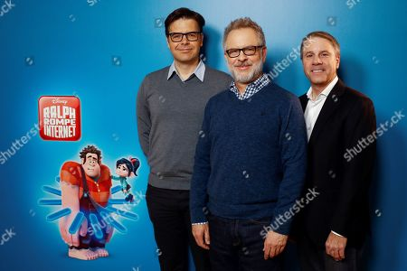 Rich Moore (C) and Phil Johnston (L) and producer Clark Spencer (R) pose for photographers during the presentation of their animation movie 'Ralph Breaks the Internet' in Madrid, Spain, 19 November 2018.