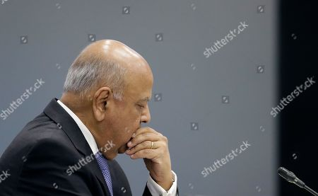 Public Enterprises Minister Pravin Gordhan appears at the judicial commission of inquiry into state capture in Johannesburg, South Africa, . Gordhan is expected to reveal details surrounding former president Jacob Zuma's trillion-rand nuclear procurement campaign as well as other corruption practices