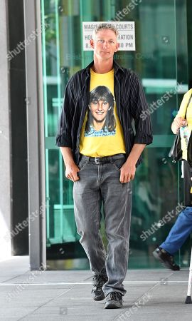 Stock Image of Kevin Mason is seen wearing a t-shirt displaying a photograph of his sister Annette Mason outside the Brisbane Coroners Court in Brisbane, Queensland, Australia, 19 November 2018. The Coroner has reopened the inquest into the death of Annette Mason who was 15-year-old when she was bludgeoned to death in her family's Toowoomba home in November 1989.