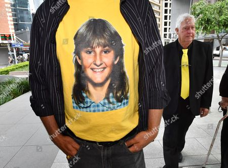 A t-shirt displaying a photograph of the victim, Annette Mason is seen as her father, Mick Mason (right) walks outside the Brisbane Coroners Court in Brisbane, Queensland, Australia, 19 November 2018. The Coroner has reopened the inquest into the death of Annette Mason who was 15-year-old when she was bludgeoned to death in her family's Toowoomba home in November 1989.