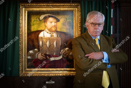 David Starkey with a portrait of Henry V|||, in the Long Gallery at Hever Castle, the childhood home of Anne Boleyn.