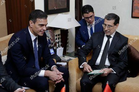 Morocco's Prime Minister Saad Eddine el-Othmani, right, greets his Spanish counterpart Pedro Sanchez prior to their meeting, in Rabat, Morocco, Monday, Nov, 19, 2018