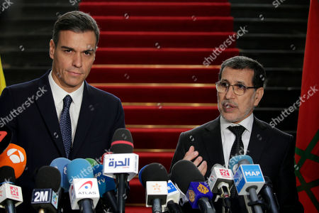 Morocco's Prime Minister Saad Eddine el-Othmani, right, and his Spanish counterpart Pedro Sanchez answer questions during a joint presse conference held in Rabat, Morocco, Monday, Nov, 19, 2018
