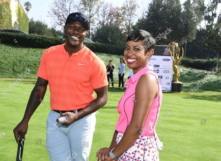 Kellee Edwards, Edwin Hodge. Edwin Hodge, left, and Kellee Edwards took part in the 19th Annual Emmys Golf Classic at the Wilshire Country Club on in Los Angeles