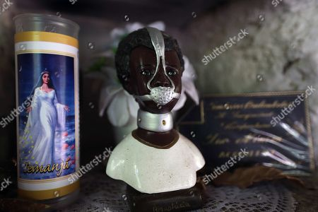 A doll of the slave Anastacia, venerated by the blacks as a saint, is seen in the Sacopa quilombo (a reservation for descendants of slaves), a small land located in one of the hills that borders the Rodrigo de Freitas lagoon, surrounded by luxurious residences in the city of Rio de Janeiro, Brazil, 14 November 2018. (issued 19 November 2018). The survivors of a redoubt of descendants of black slaves located in one of the most appreciated areas of the Brazilian city of Rio de Janeiro fight against real estate speculation that has been trying to expel them from their homes for decades.