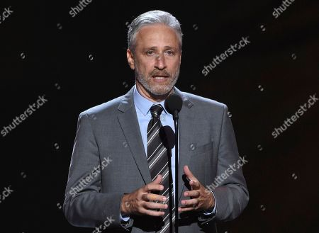 Jon Stewart. On Stewart presents the Pat Tillman award for service at the ESPY Awards at Microsoft Theater in Los Angeles. Stewart surprised construction workers at a New Jersey performing arts theater with a free lunch. Stewart appeared behind the window of the Shore Good Eats food truck outside the Count Basie Center of the Arts in Red Bank, Wednesday, Sept. 26, handing out sandwiches and cookies