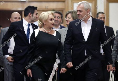 Romanian Prime Minister Viorica Dancila (front L) arrives for the Sociial Democracy Party (PSD) executive meeting for consultations regarding her cabinet reshuffle with PSD leader Liviu Dragnea (R), the president of the Romanian Parliament's Deputy Chamber and the leader of the main ruling party PSD at the Parliament Palace in Bucharest, Romania, 19 November 2018. Heads of PSD ruling party decided today a cabinet reshuffle. Prime minister Viorica Dancila nominated, at the end of the party meeting, eight new ministers from a total of 26. The ministers of transports, labour, communications, culture, sports & youth, public administration and development, as well as defense were restructured. Defense Minister Mihai Fifor (not pictured) who resigned before the party meeting, received a high level interim position inside the party management team. Romania is preparing to take the Presidency of the Council of the European Union for six months, starting on 01 January 2019.