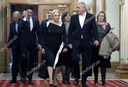 Stock Image of Romanian Prime Minister Viorica Dancila (C-L) arrives for the Sociial Democracy Party (PSD) executive meeting for consultations regarding her cabinet reshuffle with PSD leader Liviu Dragnea (C-R), the president of the Romanian Parliament's Deputy Chamber and the leader of the main ruling party PSD at the Parliament Palace in Bucharest, Romania, 19 November 2018. Heads of PSD ruling party decided today a cabinet reshuffle. Prime minister Viorica Dancila nominated, at the end of the party meeting, eight new ministers from a total of 26. The ministers of transports, labour, communications, culture, sports & youth, public administration and development, as well as defense were restructured. Defense Minister Mihai Fifor (not pictured) who resigned before the party meeting, received a high level interim position inside the party management team. Romania is preparing to take the Presidency of the Council of the European Union for six months, starting on 01 January 2019.