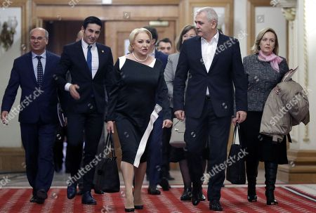 Stock Picture of Romanian Prime Minister Viorica Dancila (C) arrives for the Sociial Democracy Party (PSD) executive meeting for consultations regarding her cabinet reshuffle with PSD leader Liviu Dragnea (2-R), the president of the Romanian Parliament's Deputy Chamber and the leader of the main ruling party PSD at the Parliament Palace in Bucharest, Romania, 19 November 2018. Heads of PSD ruling party decided today a cabinet reshuffle. Prime minister Viorica Dancila nominated, at the end of the party meeting, eight new ministers from a total of 26. The ministers of transports, labour, communications, culture, sports & youth, public administration and development, as well as defense were restructured. Defense Minister Mihai Fifor (not pictured) who resigned before the party meeting, received a high level interim position inside the party management team. Romania is preparing to take the Presidency of the Council of the European Union for six months, starting on 01 January 2019.