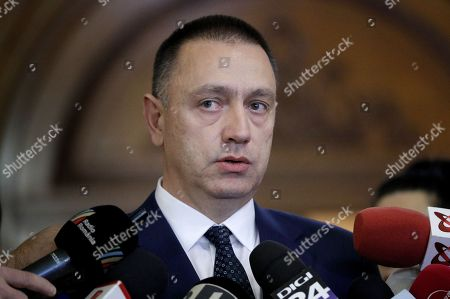Romanian Defense Minister Mihai Fifor makes a statement before to enter for the Social Democracy Party (PSD) executive meeting that decided a cabinet reshuffle, at the Parliament Palace in Bucharest, Romania, 19 November 2018. Heads of PSD ruling party decided today a cabinet reshuffle. Prime minister Viorica Dancila nominated, at the end of the party meeting, eight new ministers from a total of 26. Defense Minister Mihai Fifor (not pictured) who resigned before the party meeting, received a high level interim position inside the party management team. Romania is preparing to take the Presidency of the Council of the European Union for six months, starting on 01 January 2019.