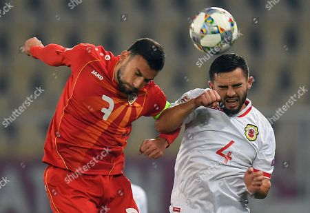 Macedonia's Ivan Trickovski (L) in action against Gibraltar player John Sergeant during the UEFA Nations League match between FYR of Macedonia and Gibraltar in Skopje, The Former Yugoslav Republic of Macedonia, 19 November 2018.