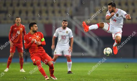 Stock Image of Gibraltar's John Sergeant (R) in action against Macedonia's Ivan Trichkovski during the UEFA Nations League match between FYR of Macedonia and Gibraltar in Skopje, The Former Yugoslav Republic of Macedonia, 19 November 2018.
