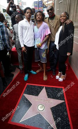 Snoop Dogg (2R) poses with his wife Shante Taylor (R) and his sons Corde and Cordell following a ceremony honoring him with a star on the Hollywood Walk of Fame in Hollywood, California, USA, 19 November 2018. Snoop Dogg received the 2,651st star in the category of Recording.