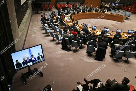 United Nations chief mediator for Syria, Staffan de Mistura, shown center in a live video broadcast, briefs the U.N. Security Council, at U.N. headquarters