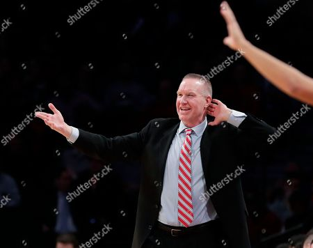 St. John's head coach Chris Mullin reacts during the first half of an NCAA college basketball game against California in the Legends Classic tournament, in New York