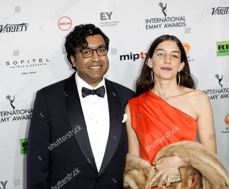 Hari Kondabolu (L) and his guest arrive at the 46th International Emmy Awards Gala at the New York Hilton hotel in New York, New York, USA, 19 November 2018.