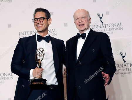 United States writer Greg Berlanti (L) poses with his Founders Award next to Bruce Paisner (R), President and CEO of the International Academy of Television Arts and Sciences (R) during the 46th International Emmy Awards Gala at the New York Hilton hotel in New York, New York, USA, 19 November 2018.