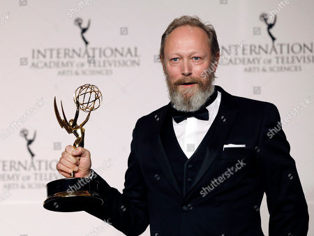 Lars Mikkelsen holds his award for Best Performance By an Actor during the 46th International Emmy Awards Gala at the New York Hilton hotel in New York, New York, USA, 19 November 2018.