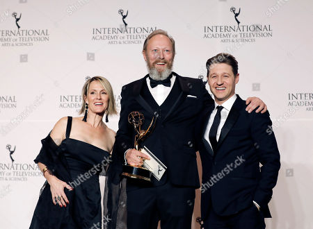 United States actress Mary Stuart Masterson (L) along with US actor Ben McKenzie (R) pose with Danish actor Lars Mikkelsen (C) as he holds his award for Best Performance By an Actor during the 46th International Emmy Awards Gala at the New York Hilton hotel in New York, New York, USA, 19 November 2018.