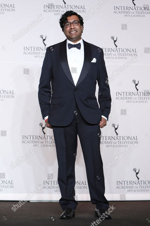 International Emmy Awards Host Hari Kondabolu poses in the press room during the 46th International Emmy Awards gala in New York City on