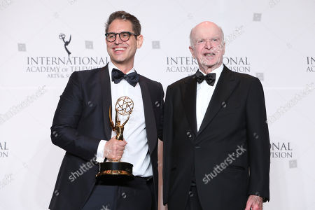 Greg Berlanti, Bruce Paisner. US writer/producer Greg Berlanti, left, poses with his Founders Award next to President and CEO of the International Academy of Television Arts and Sciences Bruce Paisner (R) pose in the press room during the 46th International Emmy Awards gala in New York City on