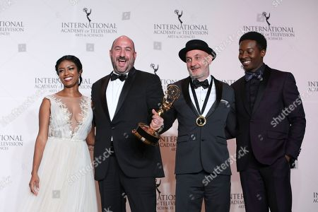 Nana Mensah, Antonino Ballestrazzi, Hernan Caffiero, Brandon Micheal Hall. From left to right, Ghanaian-US actress Nana Mensah, producer Antonino Ballestrazzi, director Hernan Caffiero and Brandon Micheal Hall pose in the pressroom with the award for Short-Form Series for 'Una Historia Necesaria' during the 46th International Emmy awards gala in New York City