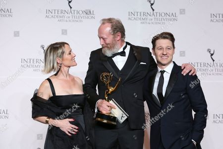 Mary Stuart Masterson, Lars Mikkelsen, Benjamin McKenzie. Actress Mary Stuart Masterson, left, actor Lars Mikkelsen, center, and actor Benjamin McKenzie pose in the pressroom with Danish who won the award for Best Performance by an Actor during the 46th International Emmy Awards gala in New York City