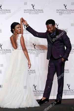 Javicia Leslie, Brandon Micheal Hall. Actress Javicia Leslie and actor Brandon Micheal Hall pose in the press room during the 46th International Emmy Awards gala in New York City