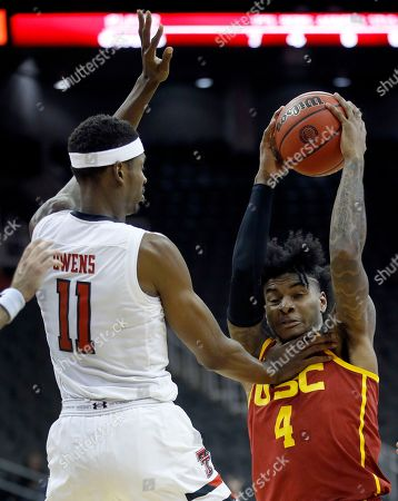 Stock Image of Texas Tech's Tariq Owens (11) pressures USC's Kevin Porter Jr. (4) during the second half of an NCAA college basketball game, in Kansas City, Mo. Texas Tech won 78-63