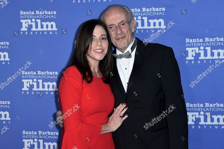 Jane Walker Wood, Christopher Lloyd. Jane Walker Wood, left, and Christopher Lloyd attend the 2018 Kirk Douglas Award for Excellence in Film Honoring Hugh Jackman at the Ritz-Carlton Bacara, in Goleta, Calif