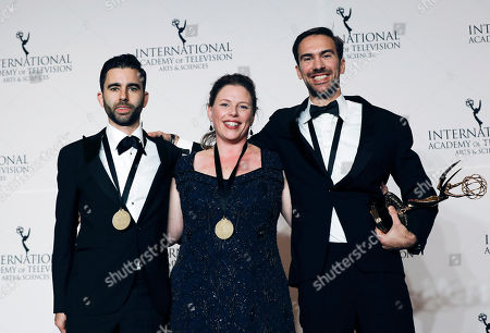 Stock Picture of United States actor and presenter Erich bergen (L), Stephane Kaas (C) and Marloes Blokker (R) hold up their award for Arts Programming -Etgar Keret: Based On A True Story during the 46th International Emmy Awards Gala at the New York Hilton hotel in New York, New York, USA, 19 November 2018.