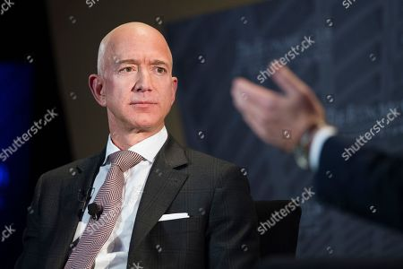 Jeff Bezos, Amazon founder and CEO, speaks at The Economic Club of Washington's Milestone Celebration in Washington. Amazon expects to begin recruiting next year for software developers, accountant, executives, managers, and human resources professionals for its new hubs in New York's Long Island City and the Washington suburb of Arlington. The employees will be hired over several years as Amazon seeks talent to support an empire that has expanded beyond retail to include cloud computing services, advertising and, video streaming and TV production